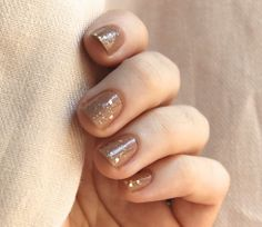 I love this color combo for fall! Light brown with gold glitter. Maybe a chocolate brown as an accent nail with the same glitter over it.