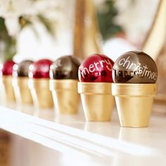Have some fun with your Christmas Ornaments. Try spelling out a holiday message on a mantel or shelf. Spray-paint small terra-cotta pots a sparkly colour and add your personalised Christmas baubles.
