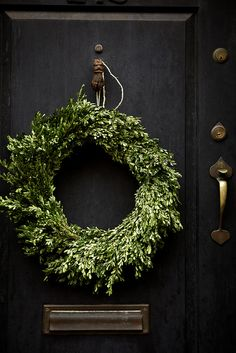 black door + boxwood wreath