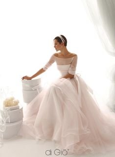 Love the tailored bodice with the flowy skirt.