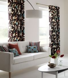 Beautiful white living room with Clarke & Clarke drapes