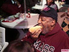 Bill Cosby enjoys a hot dog
