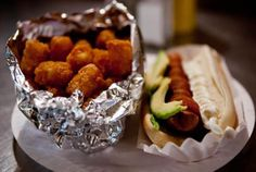 Crif Dogs - Hot dogs wrapped in bacon with avocado. Side of tater tots. Need I say more?