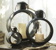 With a round iron frame, fishbowl glass and telescoping handle, our lanterns have a distinctly nautical influence. Insert candles through a side hatch where the convex glass helps magnify and protect the candlelight both indoors and out.