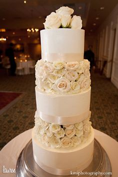 tiered wedding cake decorated with real white roses ccl wedding cakes
