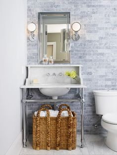 (gray tile to ceiling + tall textured basket)