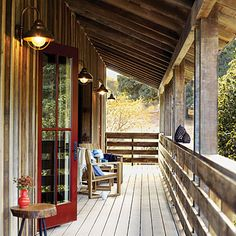 I love this porch. All I want is a barn house with a giant front porch where I can watch thunderstorms.