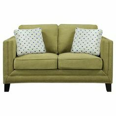 "This chic loveseat showcases nailhead-trimmed apple green upholstery and espresso-finished wood legs. 2 complementing throw pillows offer a pop of pattern with lovely style.    Product: LoveseatConstruction Material: Solid ash wood , elm veneer and fabricColor: Apple greenFeatures:  Includes two contrasting pillowsPocket coil seat cushionsNailhead trim Dimensions: 36.6"" H x 66.7"" W x 37"" D"