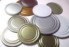How to Make Jewelry or Decorations Out of Tin Can Lids by Felicia Gustin