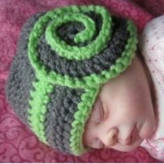 Dress up your heavenly baby with a Celestial Swirl Baby Hat. As gorgeous as swirls of stars in the sky, this crochet baby hat pattern will keep your baby snug and warm.