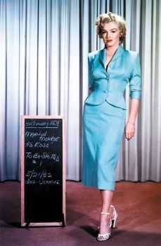 """This suit in pale turquoise dupioni silk is from """"Niagra."""" Like other costumes, Marilyn wore this one several times off screen.  She often wore costumes as they were tailor made for her measurements. The suit is by Dorothy Jeakins, a freelance costumer who won three Oscars for her work."""