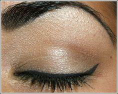 Heavy eye makeup - especially the cat-eye eyeliner.