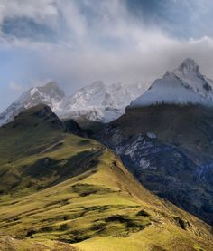 """Col d'Aubisque.  """"We were high up in the Pyrenees at the top of the Col d'aubisque even higher at 1,750 m. The weather had been cold, cold enough for snow on the top of the mountains. The white mountain tops are reaching here higher than 2600 meters. The highest peak in the Pyrenees is 3,404 meters high.""""  by Ben (Ben Thé Man)."""