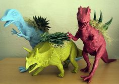 Dinosaur toy planters. Such a cute way to upcycle old toys.