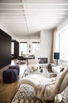 nate berkus jeremiah brent domino rita hazan apt living room neutral glam black white brass 1970s beni ourain Lucite table