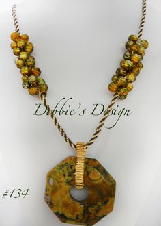Debbie's Design necklace featuring fiber kumihimo braiding and a small section of beads.