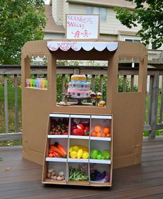 DIY store idea: make and decorate a cardboard play store for groceries, clothes, toys, etc.