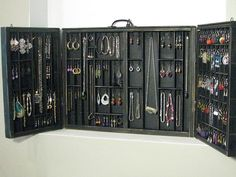 Jewellery Display .  Folds together and could be put on a table top or hung up on the wall.
