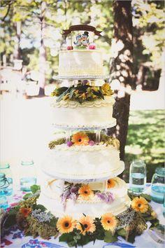 flower draped tiered wedding cake