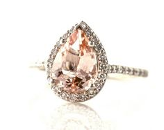 pear shaped peach engagement ring - Etsy:  RareEarth LOVE the pear cut, peach, and moisenite instead of diamond