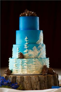 So gorgeous! Woodland wedding cake with blue ombre and white details #wedding #weddingcake #cake #woodland #ombre