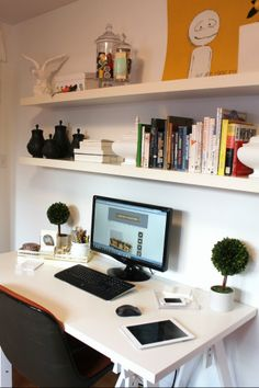 Love the topiaries on the desk + white on white.