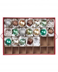 18 tips for storing and organizing ornaments. (We admit it...our trees are still up and need to come down!)