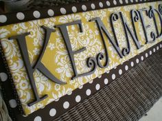 fabric and letters on canvas