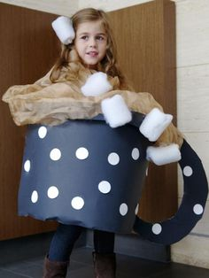 Easy Homemade Halloween Costumes For Kids: Nothing satisfies like a mug of hot chocolate on a cool October day.  Use a cardboard-covered laundry basket to make the cup, chiffon fabric for the liquid and a roll-up pillow batting for the mini marshmallows. Design by Manvi Drona From DIYnetwork.com