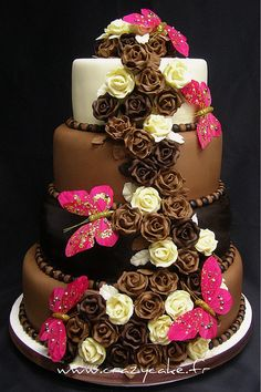Chocolate wedding cake with butterfly accents.