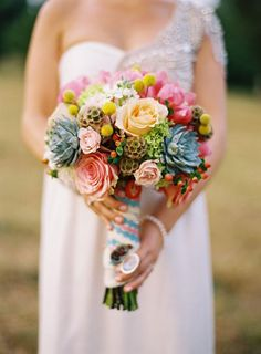 colorful bouquet with succulents // photo by Tec Petaja, design + florals by Cedarwood Weddings // View more: http://ruffledblog.com/elegant-nashville-wedding/