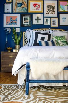 Blue + gold + eclectic gallery wall. Love this bedroom!