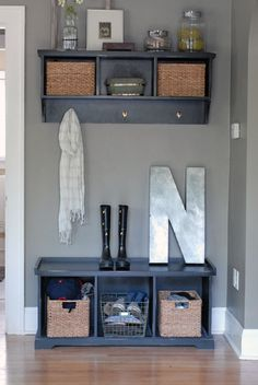 cute idea for that little recessed area immediately to the right of the front door...instead of the shelf above with hooks a nice chunky round mirrow...and if it is too narrow for a bench, perhaps a chair of some sort.
