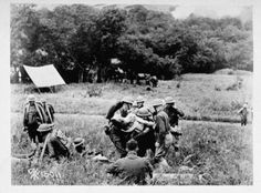 American medics carrying a wounded soldier, c 1917