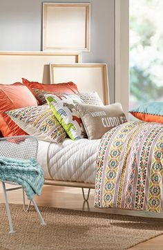 Crushing on the vibrant splash of coral and geometric patterns on this bedding collection.