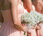 Barn wedding with tons of baby breath/wildflower decor