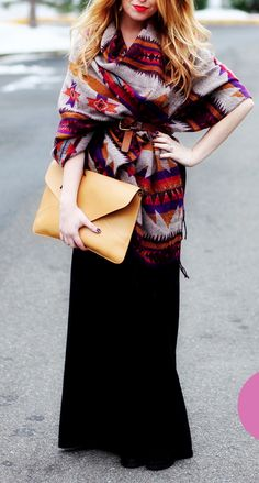 Belted shawl with a long skirt and oversize clutch