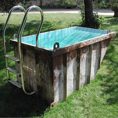 Recycled dumpster pool by Louisa Dawson