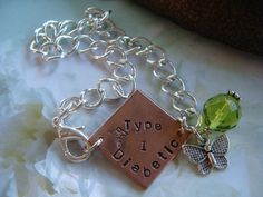 Medic Alert Bracelet for Diabetes copper and peridot crystal with butterfly. Etsy.