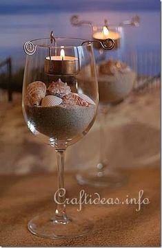 Copas con arena y caracoles, con vela colgante