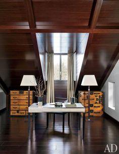 Giorgio Armani's Swiss Retreat :   Armani/Casa nickle desk with an embossed leather top