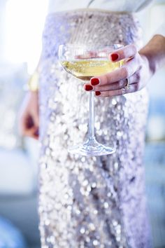 Sequin skirt and champagne on ice. And don't forget a must-have manicure