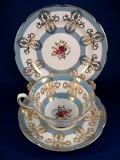 Royal Grafton Cup And Saucer With Plate Blue, White and Gold Floral