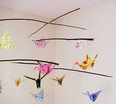 great idea for a baby shower is to have loved ones write wishes and sweet messages for the baby on the origami paper, and then fold the up the cranes and build the mobile. The mobile will carry with it all the positivity and sweetness of you and all your friends and family as it hangs out with your little one.