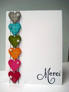 "Lines that look like guitar strings are a backdrop for these heart notes.  The heart colors are deep and coordinating, each with a pearl bling.  ""Merci"" or any other ""thank you"" sentiment is the final touch to this handmade card."