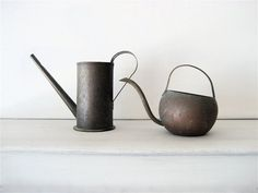 two watering cans