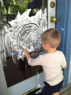 """Painting with shaving cream: This is an excellent sensory activity with endless possibilities! Painting the deck with a brush or finger painting the window may or may not turn into body painting! It started with painting his feet, then his hair, belly, and finally he was sitting in the bowl of water """"taking a bath"""". This was hours of fun and very easy clean up- which is half the fun!"""