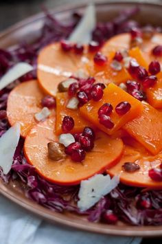 This persimmon squash salad looks almost too gorgeous to eat. butternut squash, fruit salads, apple cider vinegar, persimmon squash, squash recipes, squash salad, holiday recipes, pomegranate recipes, thanksgiving sides