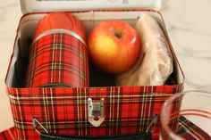 School lunches hand-packed by mom.  Sandwiches wrapped in wax paper. school, lunch boxes, vignett, sandwich, bag lunches, paper, tartan plaid, company picnic, glass