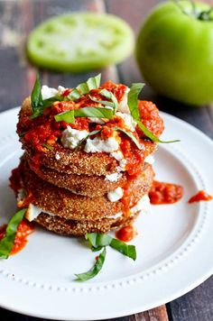 Fried Green Tomatoes with Goat Cheese and Roasted Red Pepper Vinaigrette. This Southern-meets-Italian appetizer is bound to be a late-summer hit